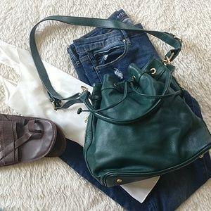 Ora Delphine Hunter green bucket bag.